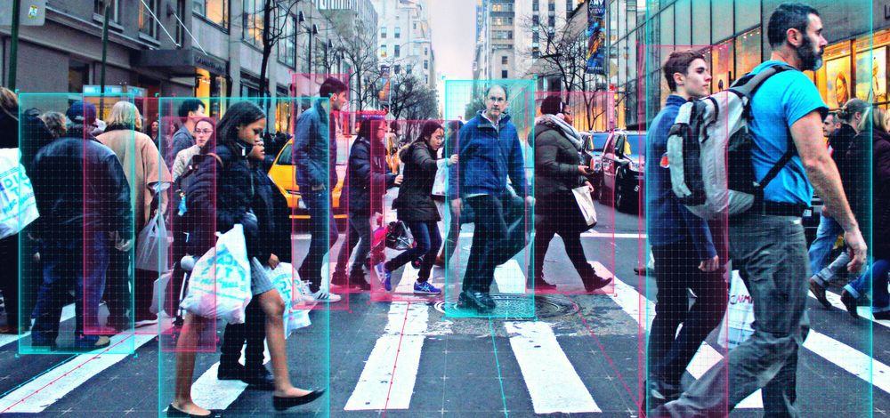 Pedestrian-detection technology in action at a busy downtown intersection crosswalk.