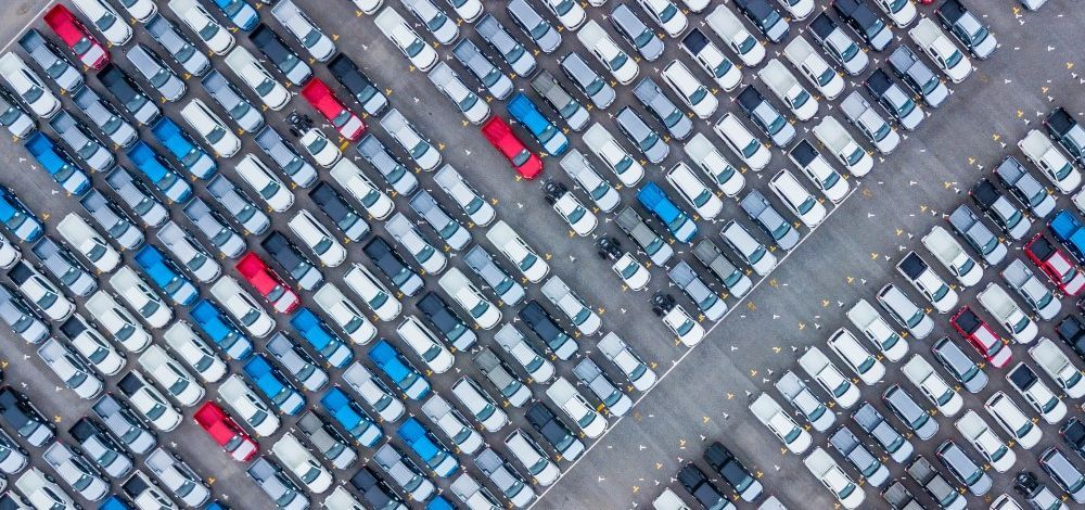 Parking lot filled with new cars and trucks